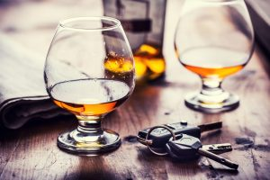 Picture of glasses of alcohol with car keys