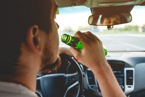 Picture of driver drinking while behind the wheel