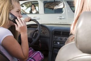 Picture of Girl driver talking on phone behind the wheel