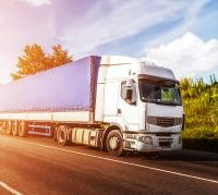 bigstock-Big-White-Truck-On-The-Road-In-296311759-300x179